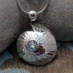 'Fossils in Silver' Small Pendant set with Sky Blue Topaz