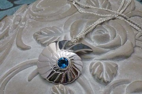 'Fossils in Silver' Pendant set with London Blue Topaz