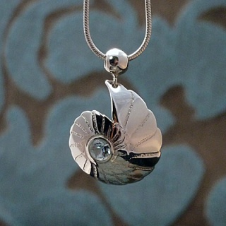'Fossils in Silver' Pendant set with sky blue topaz
